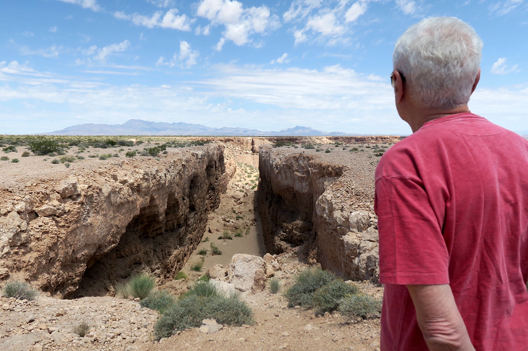 Poet and artist John Giorno at Michael Heizer's Double Negative.