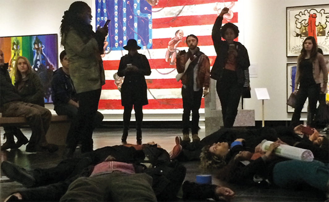 "Tacoma Action Collective die-in at the exhibition ""Art AIDS America,"" Tacoma Art Museum, WA, December 17, 2015. Photo: Saiyare Rafael."