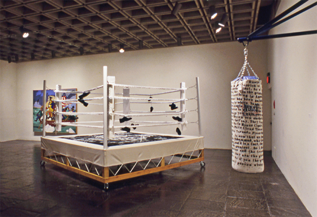 "View of ""Black Male: Representations of Masculinity in Contemporary American Art,"" Whitney Museum of American Art, New York, 1994–95. From left: Robert Colescott, George Washington Carver Crossing the Delaware: Page from American History, 1975; Gary Simmons, Step in the Arena (The Essentialist Trap), 1994; Byron Kim and Glenn Ligon, Rumble Young Man Rumble, 1993. Photo: Geoffrey Clements."
