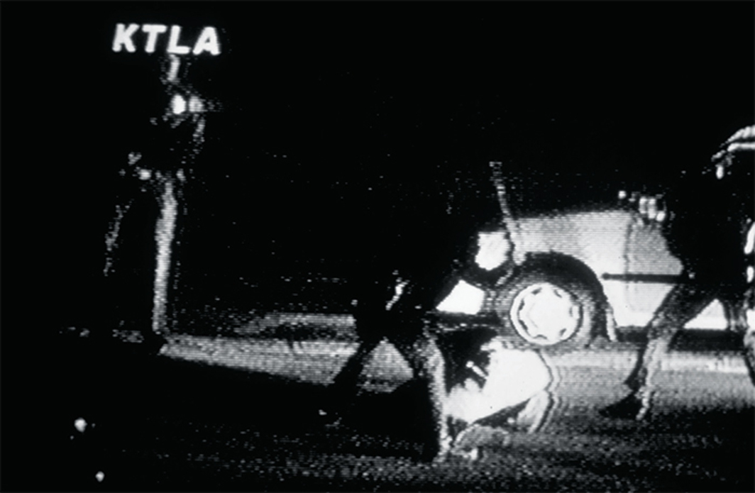 Still from George Holliday's video of LA police beating Rodney King, March 3, 1991. From a broadcast on KTLA News, Los Angeles, March 4, 1991.