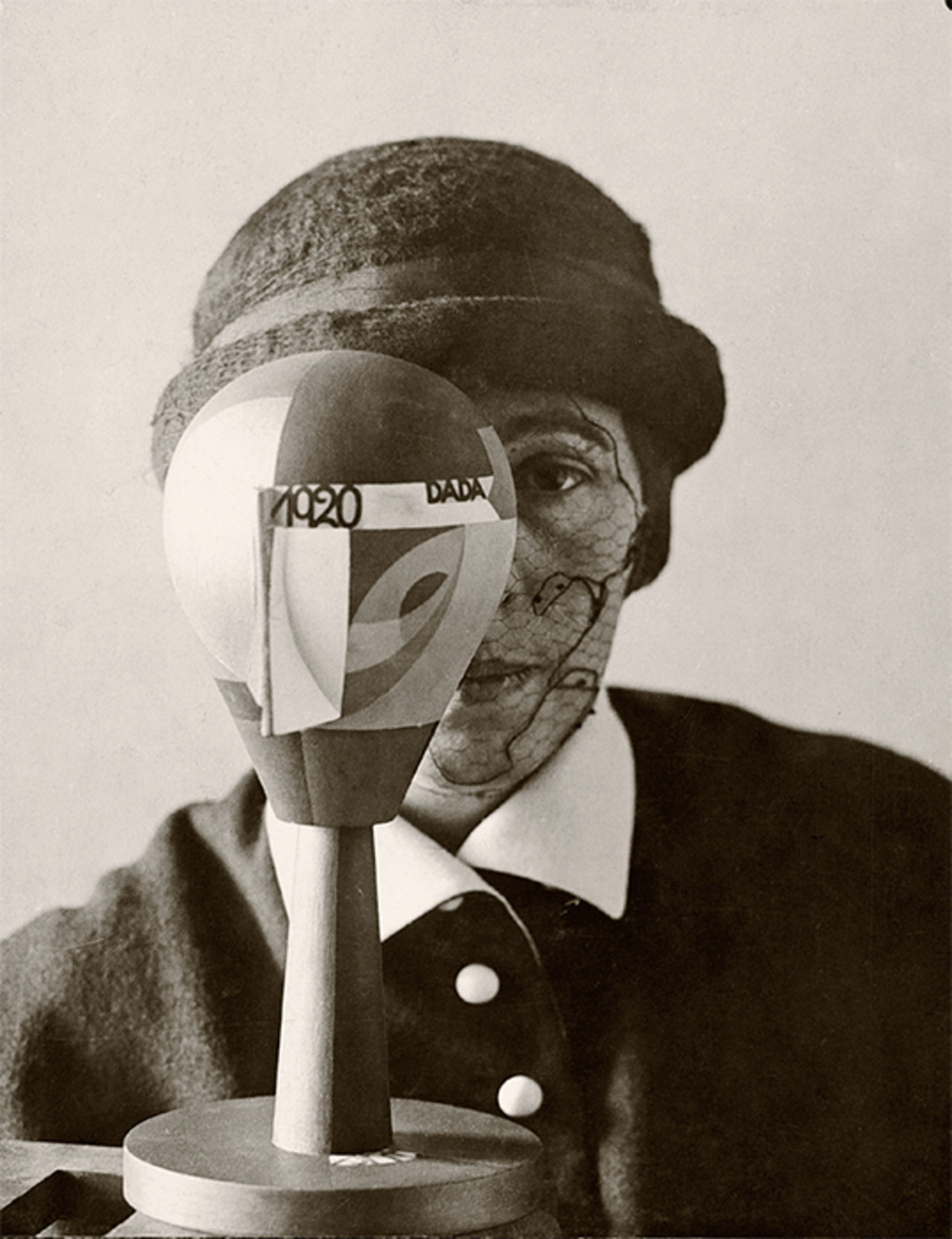 "Nic Aluf, Portrait of Sophie Taeuber with Dada Head, 1920, gelatin silver print, 8 1/4 × 6 1/2"". From ""Dadaglobe Reconstructed."""