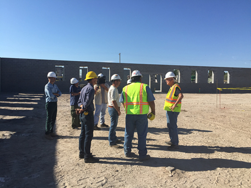 Robert Irwin with a construction crew at the Chinati Foundation, Marfa, Texas, 2015.