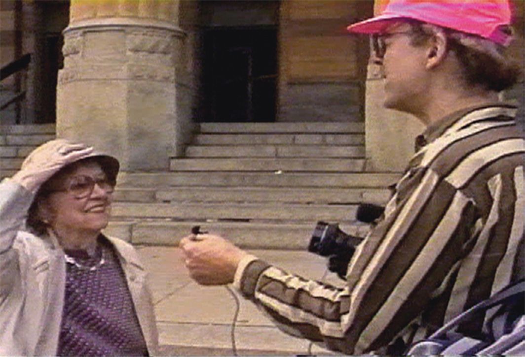 The First Amendment Network, Studio of the Streets, 1990–93, still from a public-access cable TV show on public television, Buffalo. Right: Tony Conrad. © Tony Conrad Estate.