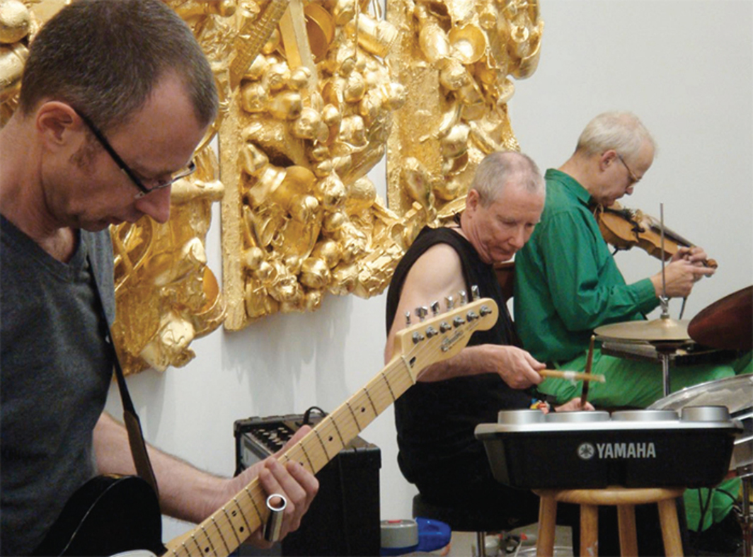 "Mike Kelley and Tony Conrad performing with XXX Macarena at the opening of ""John Miller: The New Honeymooners,"" Friedrich Petzel Gallery, New York, January 18, 2008. From left: John Miller, Mike Kelley, Tony Conrad. Photo: Colby Bird."