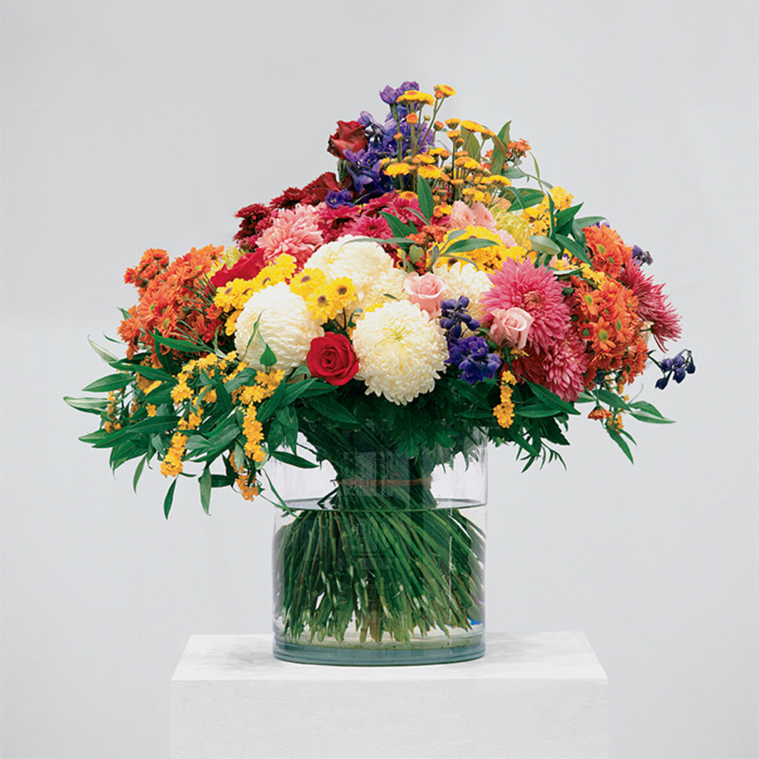"Jeroen de Rijke/Willem de Rooij, Bouquet I, 2002, flowers, vase, wooden pedestal, written description, list of flowers. From the series ""Bouquets,"" 2002–. Installation view, Galerie Buchholz, Cologne."