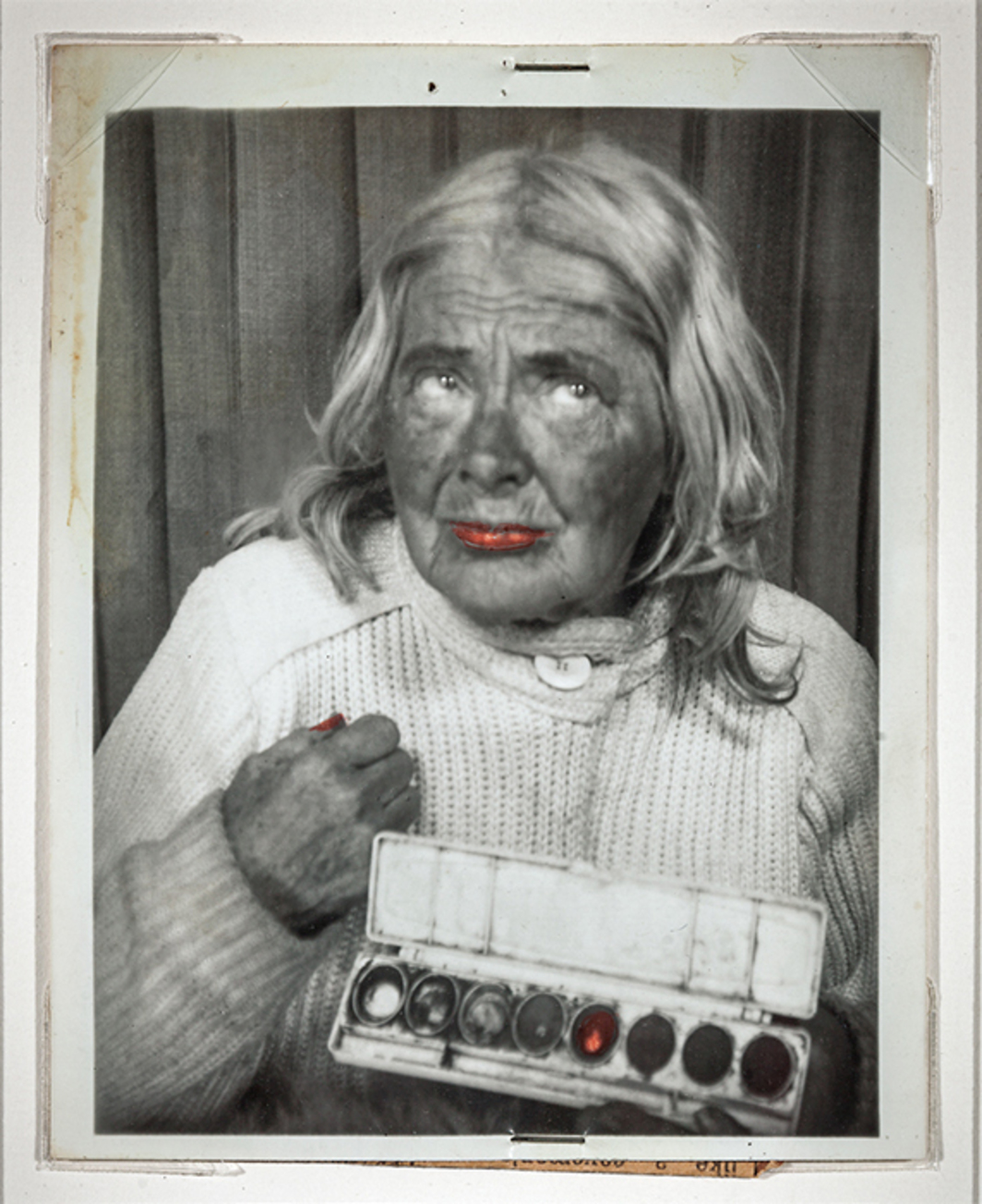 "Lee Godie, Untitled (self-portrait with paint box), n.d., gelatin silver print, 4 7/8 × 3 7/8""."
