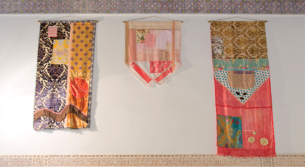 "View of ""Memory Games: Ahmed Bouanani Now,"" 2016, Bahia Palace. From left: Yto Barrada, #18 Majdoub Appliqué Flag, 2016; Yto Barrada, #48 Majdoub Appliqué Flag, 2016; Yto Barrada, #15 Majdoub Appliqué Flag, 2016. From the Marrakech Biennale 6. Photo: Jens Martin."