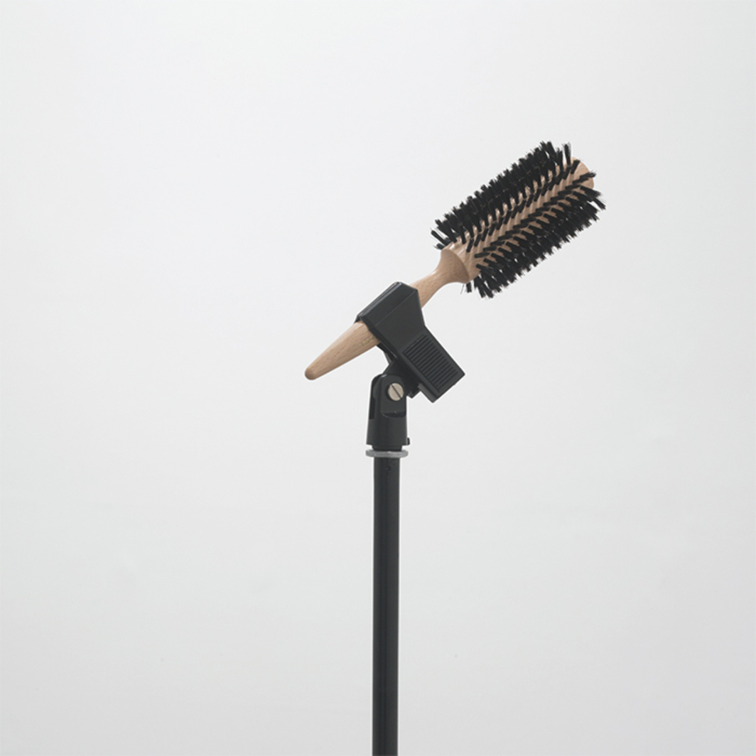 "Ceal Floyer, Solo (detail), 2006, microphone stand, microphone holder, hairbrush, 54 3/8 × 25 1/4 × 25 1/4""."