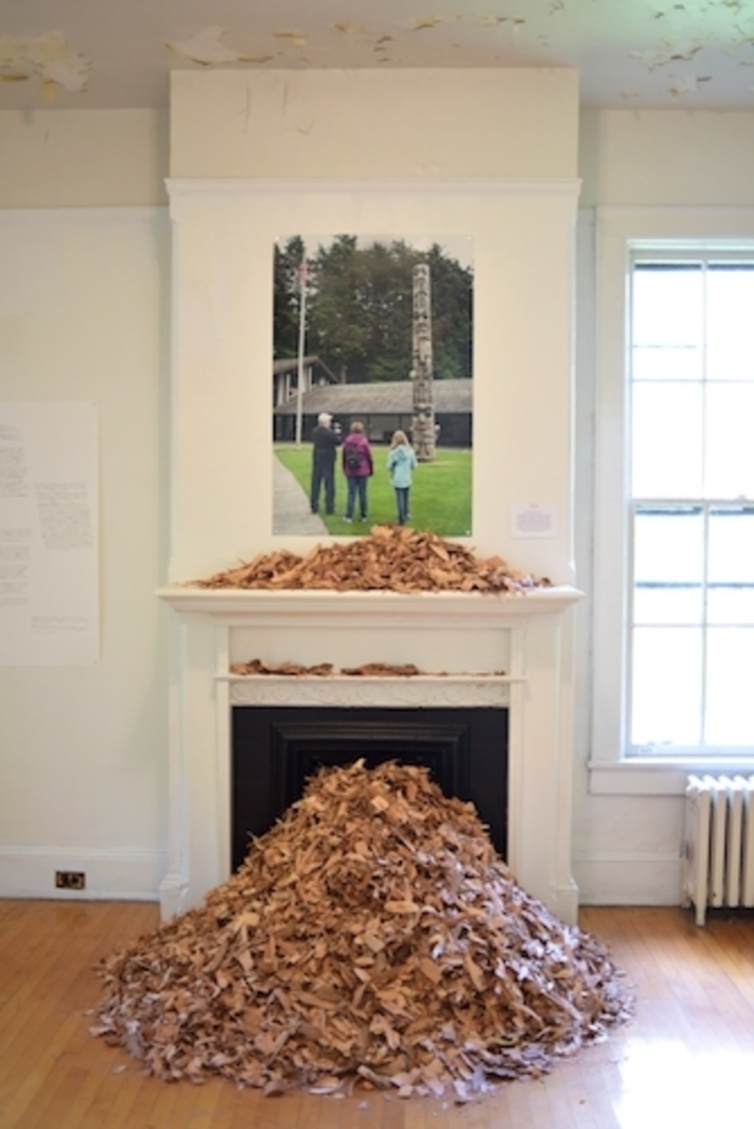Nicholas Galanin, You Are On Indisneyian Land, 2016, photograph, red-cedarwood shavings, dimensions variable.
