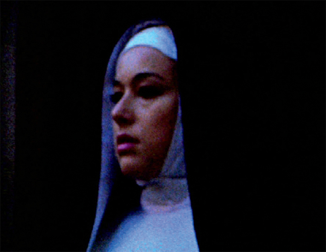 Still from Ellen Cantor's Pinochet Porn, 2008–16, Super 8 transferred to video, black-and-white and color, sound, 122 minutes. The Nun (Rosalie Knox).