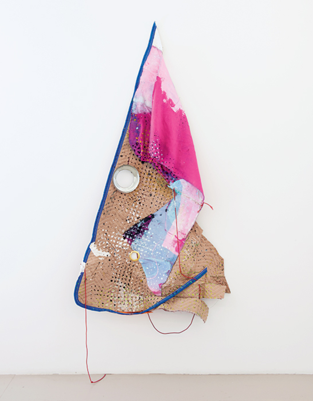 "Eric Mack, Avonte, 2015, acrylic on moving blanket and felt blanket, elastic rope, metal grommets, 81 × 72 × 7"". Installation view, Company Gallery, New York."