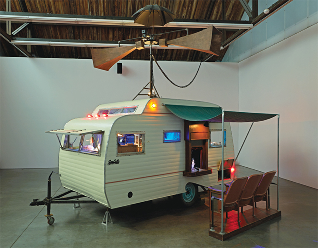 "Janet Cardiff and George Bures Miller, The Marionette Maker, 2014, caravan, marionettes, robotics, lighting, audio (14 minutes), mixed media, 15' 4"" × 18' 6"" × 10' 10""."