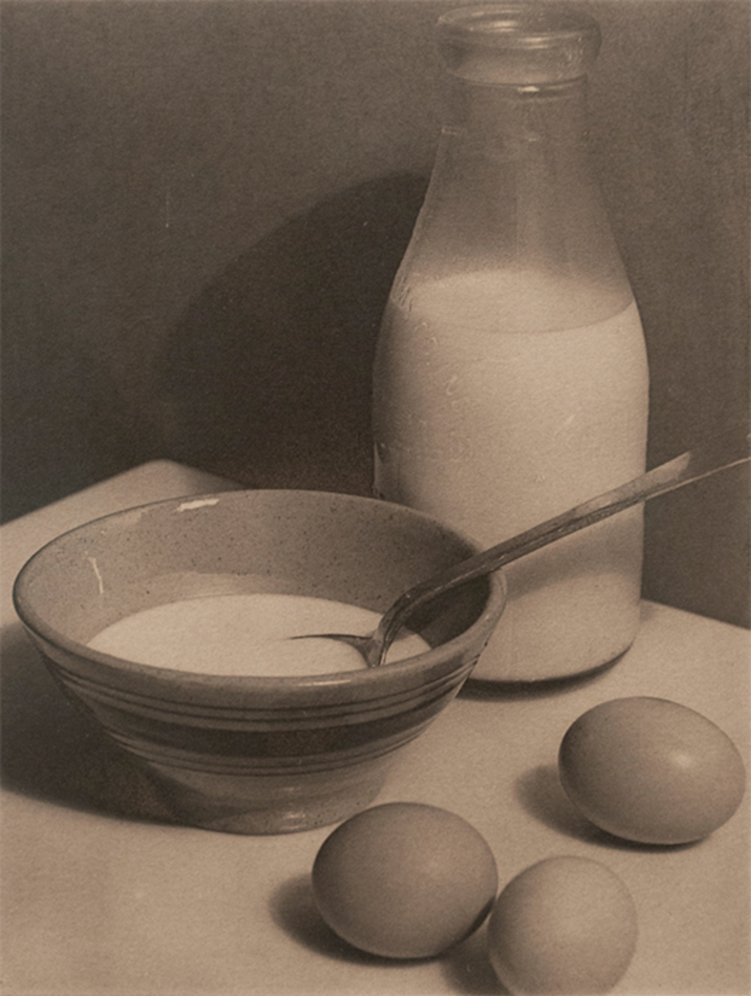 "Paul Outerbridge, The Kitchen Table: A Study in Ellipses, 1921, platinum print, 4 1/2 × 3 1/2""."