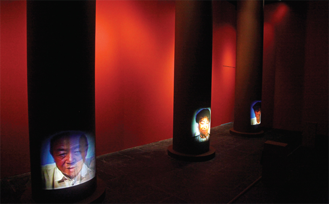 "Song Dong, Father and Son in the Former Ancestral Temple, 1998, three-channel video, color, sound; 6 minutes, 11 minutes, 4 minutes 50 seconds. Installation view. From ""An Exhibition About Exhibitions."" Photo: Zhang Ying."