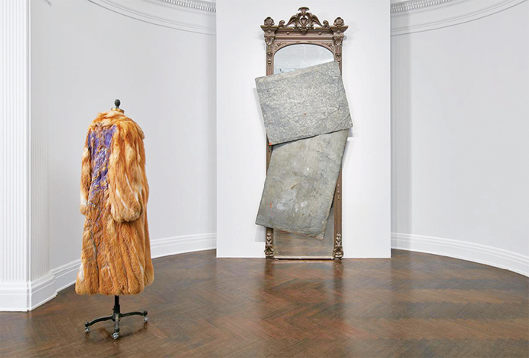 "*View of ""David Hammons: Five Decades,"" 2016*, Mnuchin Gallery, New York. From left: _Fur Coat_, 2007; _Untitled_, 2014. Photo: Tom Powel."