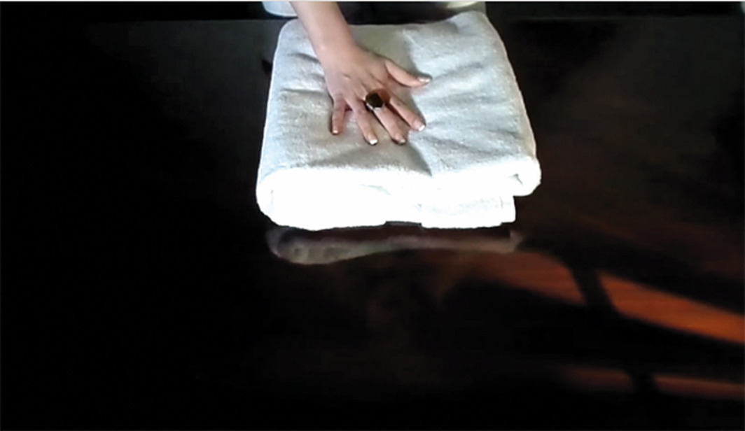 Still from GentleWhispering's 2014 YouTube video ~ Relaxing Fluffy Towels Folds ~, 26 minutes 14 seconds.