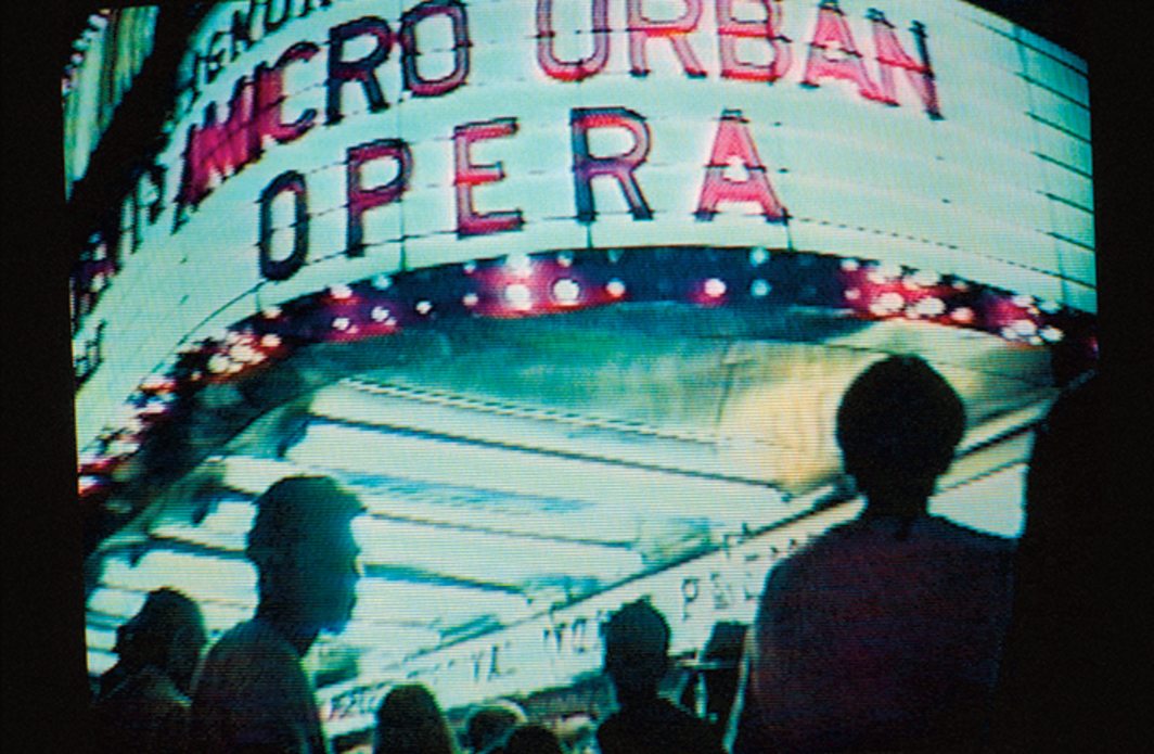 Still from a live video feed showing the Million Dollar Theatre marquee during Daniel Joseph Martinez's Ignore the Dents: A Micro Urban Opera, Los Angeles, September 1990.