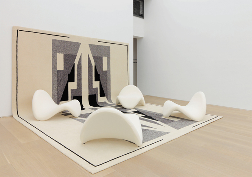 "View of ""Pierre Paulin,"" 2016. Wall and floor: Diwan rug, 1992. On rug: Tongue chairs, 1967. Photo: Guillaume Ziccarelli."