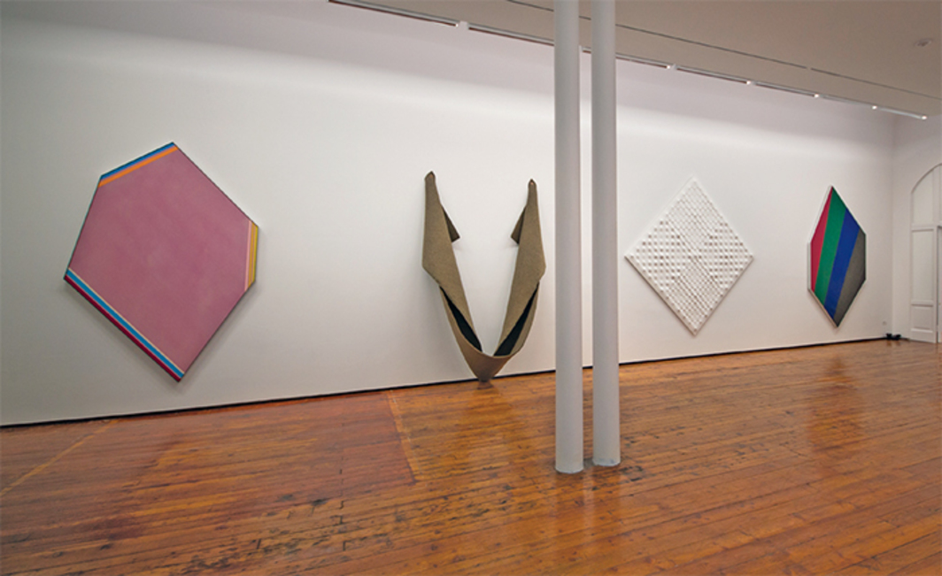 "View of ""Enrico Castellani, Robert Mangold, Robert Morris, Kenneth Noland,"" 2016. From left: Kenneth Noland, Acute, 1974; Robert Morris, Untitled, 1974; Enrico Castellani, Superficie bianca (White Surface), 2001; Kenneth Noland, Blind Passage, 1977. Photo: Lucrezia Roda."