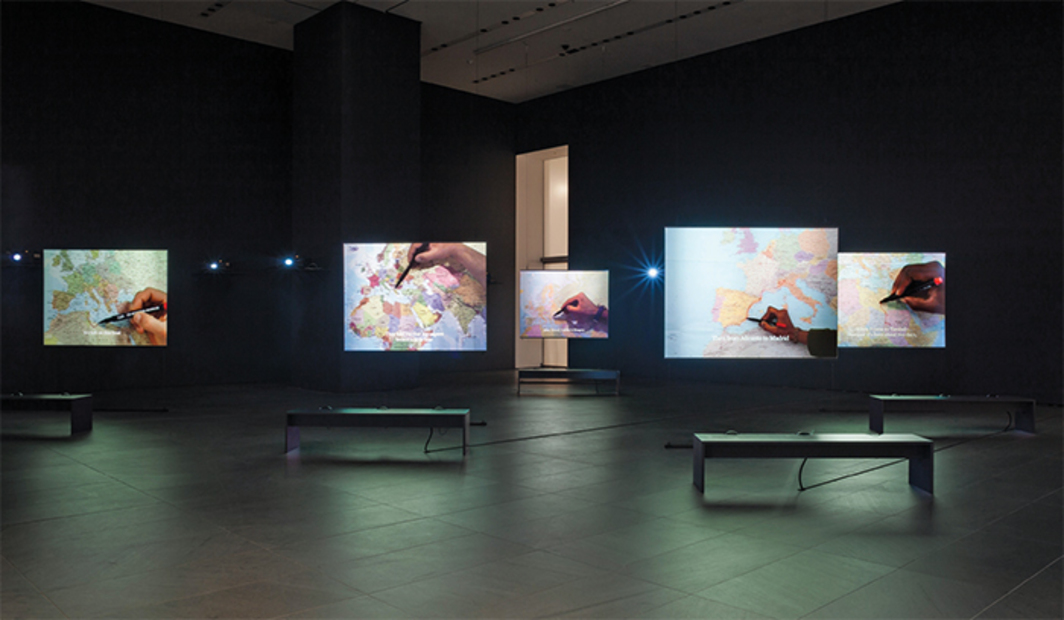 Bouchra Khalili, The Mapping Journey Project, 2008–11, eight-channel video, color, sound. Installation view, Museum of Modern Art, New York, 2016. Photo: Jonathan Muzikar.