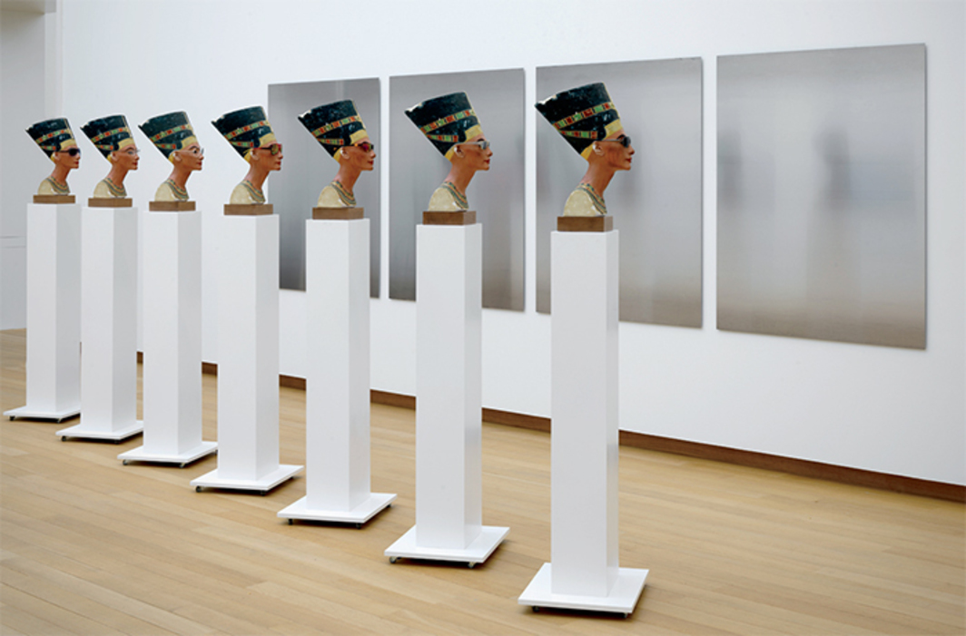 Isa Genzken, Nofretete, 2014, seven Nefertiti busts with sunglasses, seven wooden plinths on casters, four steel panels. Installation view, Stedelijk Museum, Amsterdam, 2015–16. Photo: Gert Jan van Rooij.