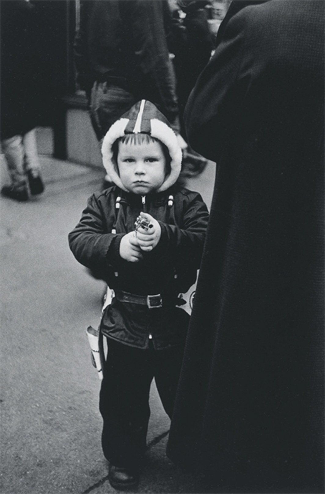 "Diane Arbus, Kid in a hooded jacket aiming a gun, N.Y.C. 1957, gelatin silver print, 8 1/2 × 5"". © The Estate of Diane Arbus, LLC. All Rights Reserved."