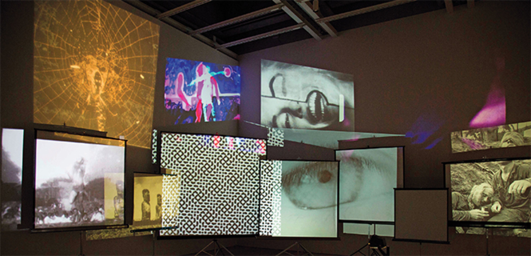 Stan VanDerBeek, Movie Mural, 1968, 35-mm slides, hand-drawn scroll, slide projectors, overhead projector, multiple 35-mm and 16-mm films transferred to video, sound. Installation view, Whitney Museum of American Art, New York. Photo: Chandra Glick.
