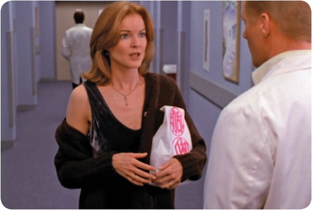 Still from the Fox TV show Melrose Place, 1992–99. Season 5, episode 9. Kimberly Shaw (Marcia Cross) and Matt Fielding (Doug Savant) with GALA Committee's Chinese Take Out, 1995–97.