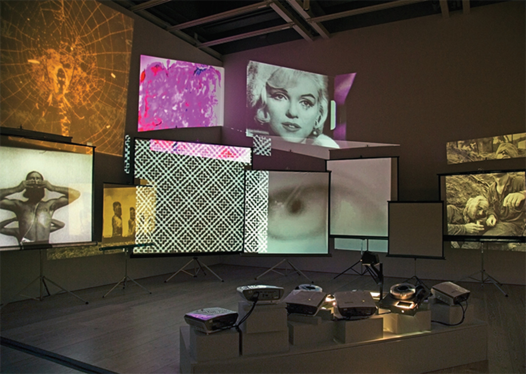 Stan VanDerBeek, Movie Mural, 1968, 35-mm slides, hand-drawn scroll, slide projectors, overhead projector, multiple 35-mm and 16-mm films transferred to video, sound. Installation view. Photo: Chandra Glick.
