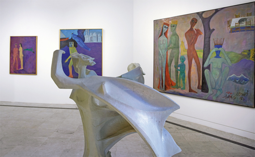 "View of ""When Art Becomes Liberty: The Egyptian Surrealists (1938–1965),"" 2016. Foreground: Abdel Hady El-Weshahy, Man of the Twentieth Century, n.d. Background, from left: Ahmed Morsi, Adam and Eve, 1959; Ahmed Morsi, Artist in Alexandria, 1989; Ahmed Morsi, Elegy of El-Gazzar, 1968."