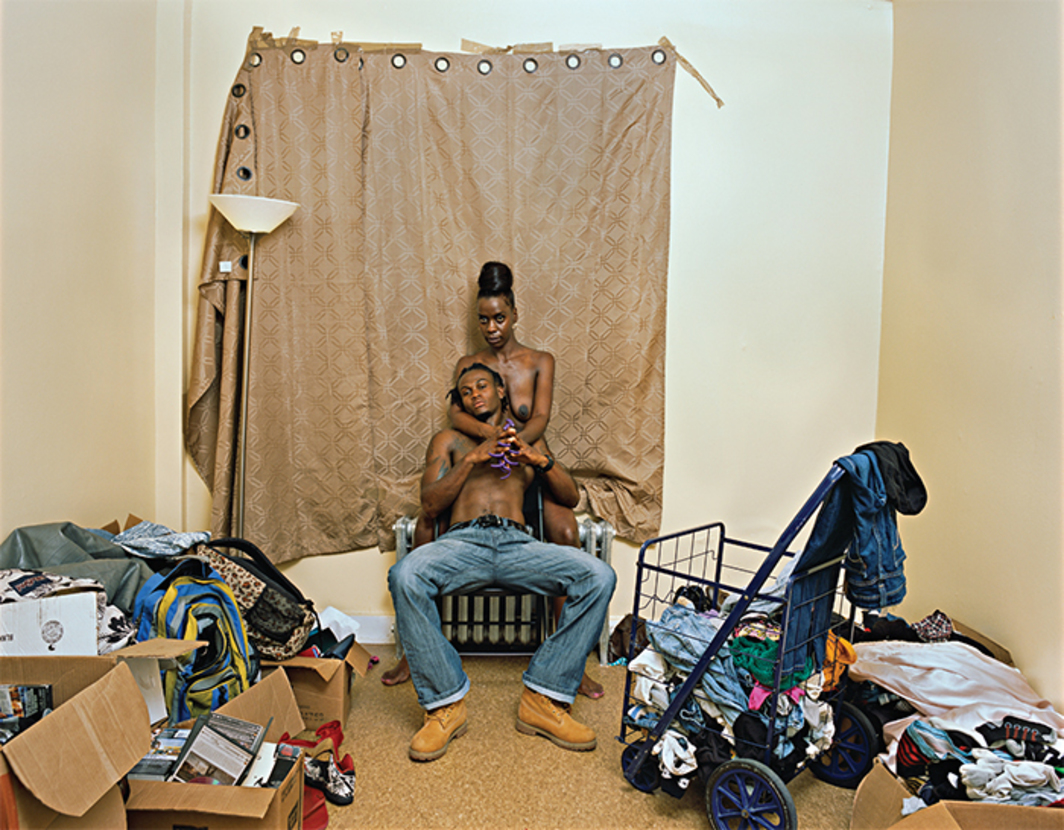 "Deana Lawson, Living Room, Brownsville, Brooklyn, 2015, ink-jet print on board, 35 × 45""."