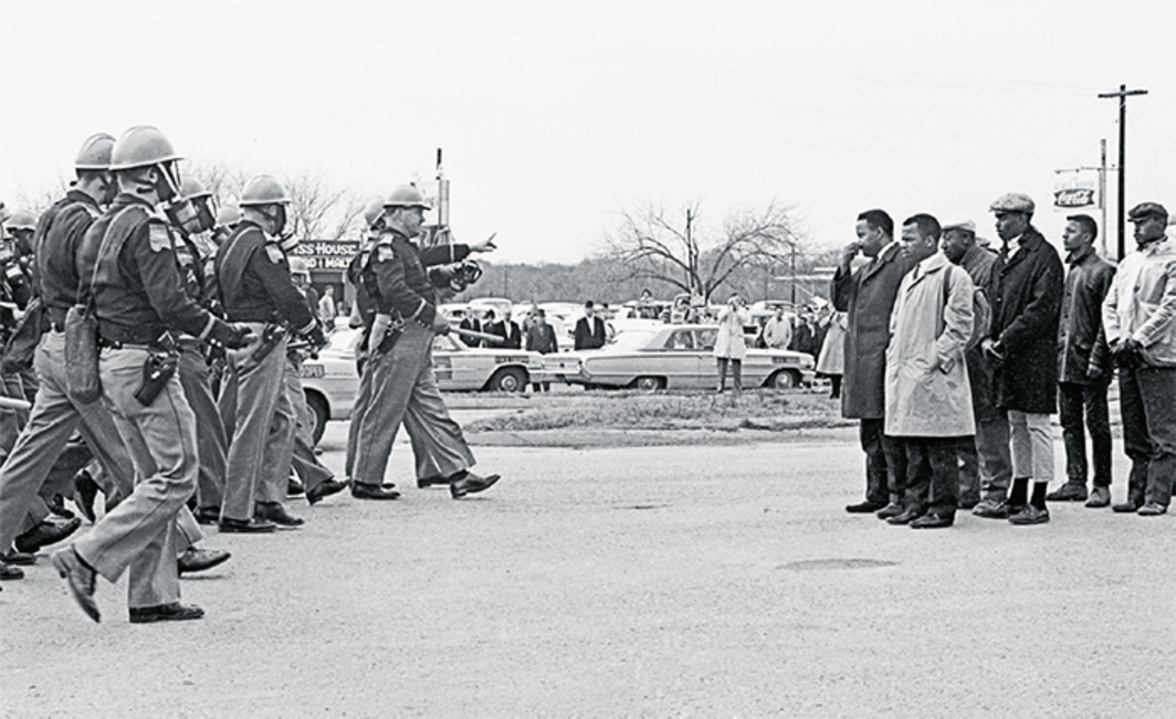 "Raoul Peck, I Am Not Your Negro, 2016, HD video, color and black-and-white, sound, 93 minutes. James ""Spider"" Martin's featured archival photograph of state troopers and civil rights activists at the Edmund Pettus Bridge, Selma, AL, March 7, 1965."