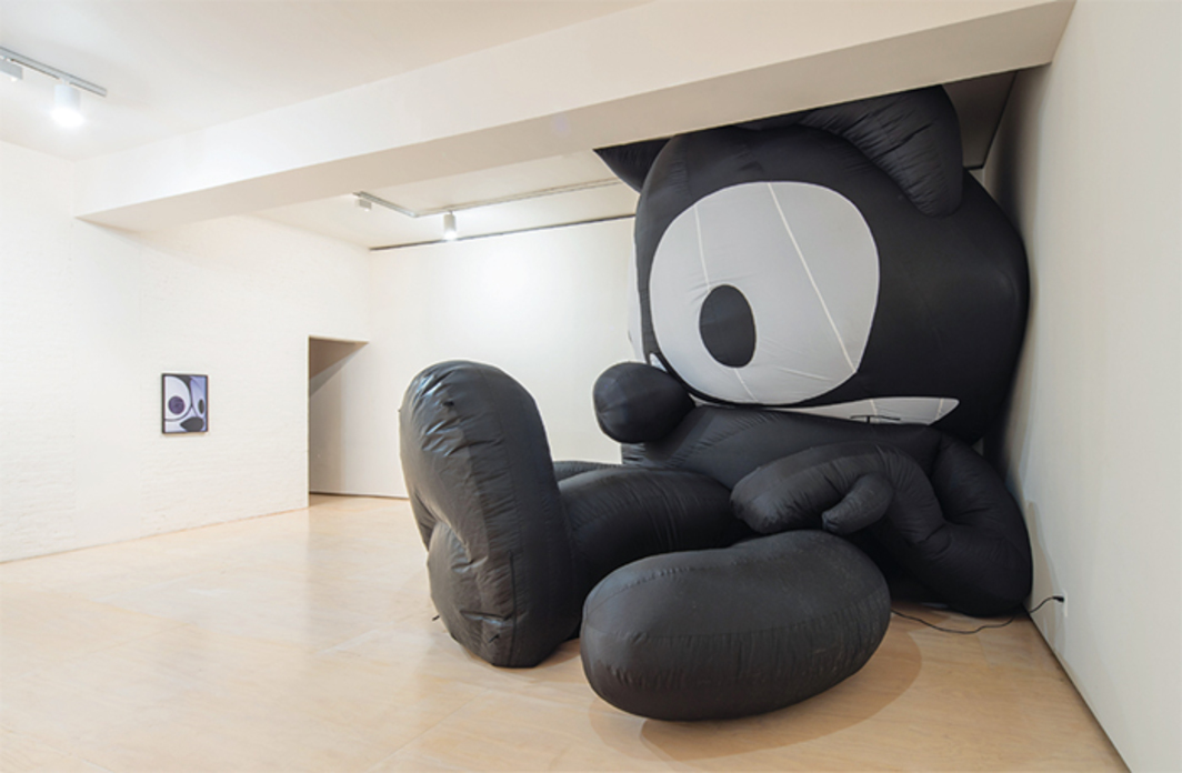 "View of ""Mark Leckey: Containers and Their Drivers,"" 2016–17. From left: Felix Mask Portrait, 2016; Felix the Cat, 2013. Photo: Pablo Enriquez."