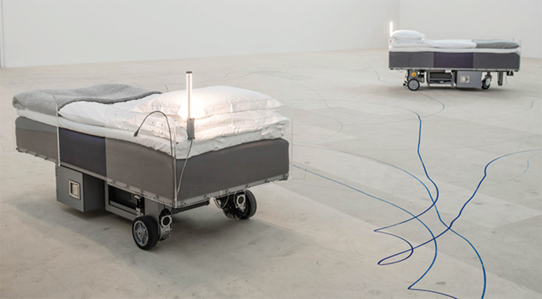 "Carsten Höller, Two Roaming Beds (Grey), 2015, mixed media, each 51 × 82 3/4 × 39"". Installation view. From ""Insomnia."" Photo: Jean Baptiste Béranger."