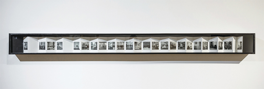"Dayanita Singh, The Gift NFS, 2005/2016, vitrine displaying accordion-fold photobook Chairs, 2005, 7 1/8 × 91 × 4 1/2"". From ""Given Time: The Gift and Its Offerings."""