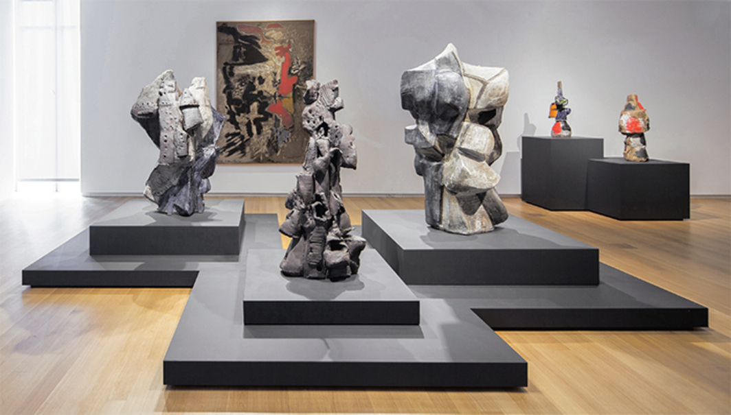 "View of ""Voulkos: The Breakthrough Years,"" 2016–17, Museum of Arts and Design, New York. On plinths, from left: Little Big Horn, 1959; Tientos, 1959; Sitting Bull, 1959; USA 41, 1960; Red River, ca. 1960. On wall: Falling Red, 1958. Photo: Butcher Walsh."
