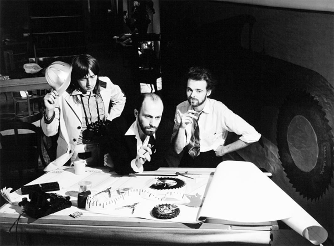 "Rodney Werden, Felix Partz, Jorge Zontal, and AA Bronson of General Idea Play the Part of the Architects of the 1984 Miss General Idea Pavilion, 1974, gelatin silver print, 15 5/8 × 19 3/4"". From left: Felix Partz, Jorge Zontal, and AA Bronson."