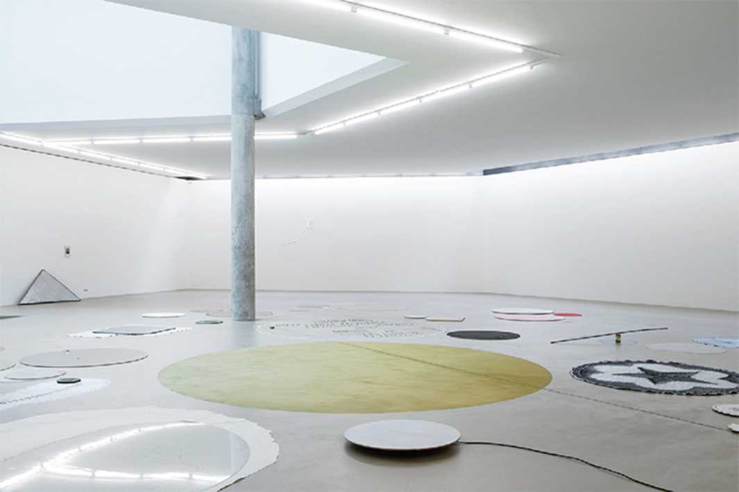 "View of ""Joëlle Tuerlinckx: Nothing for Eternity,"" 2016–17. Floor: Works from the series ""'ATOMIC AMALGAME ANNÉE 58' – FLOOR FIGURE 'RONDs-DE-SOL'"" ('Atomic Amalgam Year 58' – Floor Figure 'Floor Discs'), 2002–16. Photo: Gina Folly."