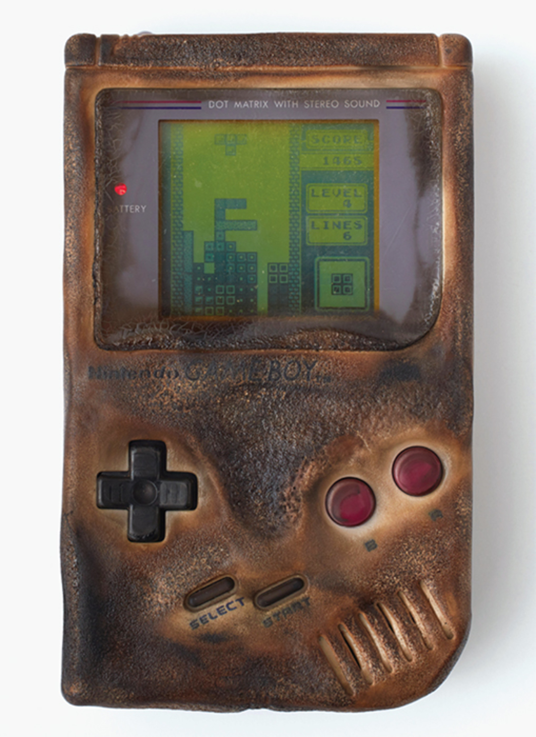 "Oliver Payne, Untitled (Replica of Game Boy Damaged in the Gulf War), 2016, Game Boy console, 5 3/4 × 3 1/2 × 1 1/4""."