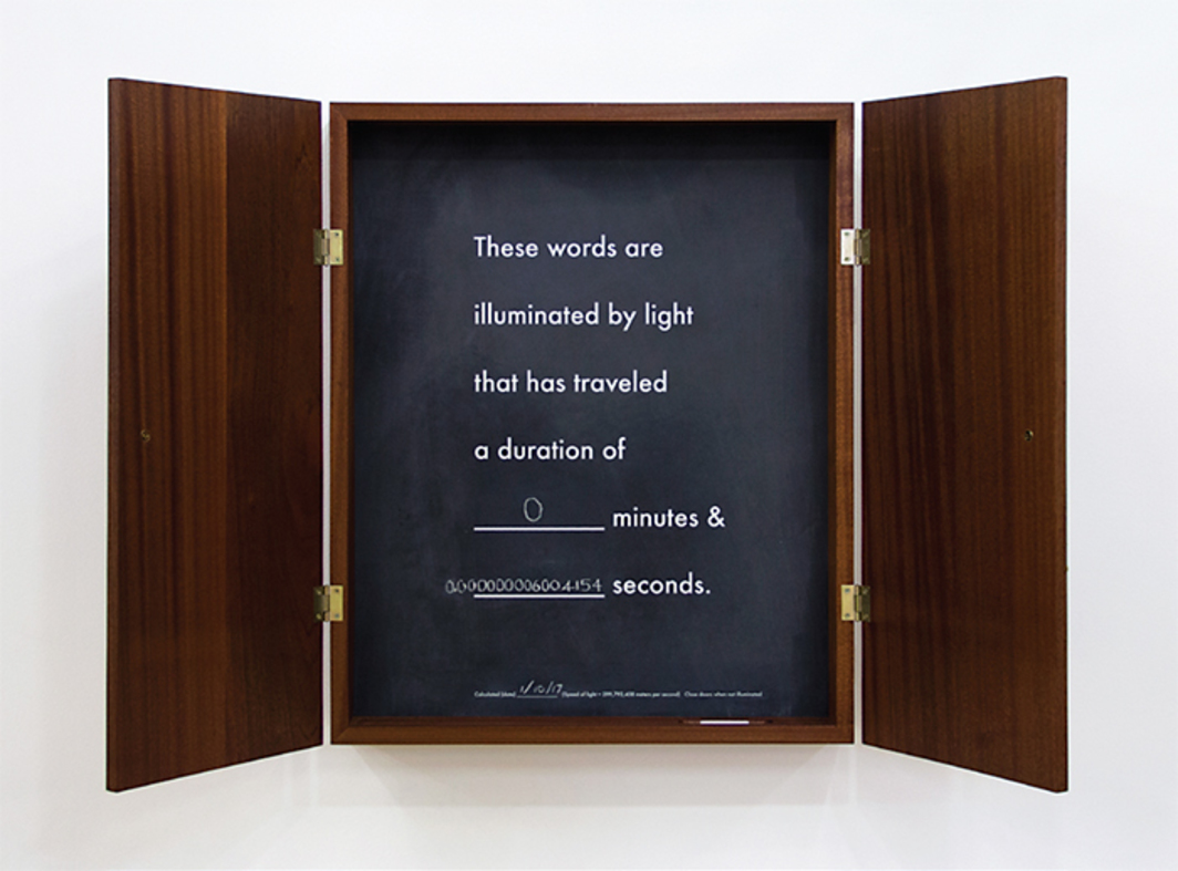 "Matthew Buckingham, Celeritas, 2009, screen-printed letters on chalkboard enclosed in wooden cabinet, natural light, 27 × 22 × 4"". From ""January Show."""