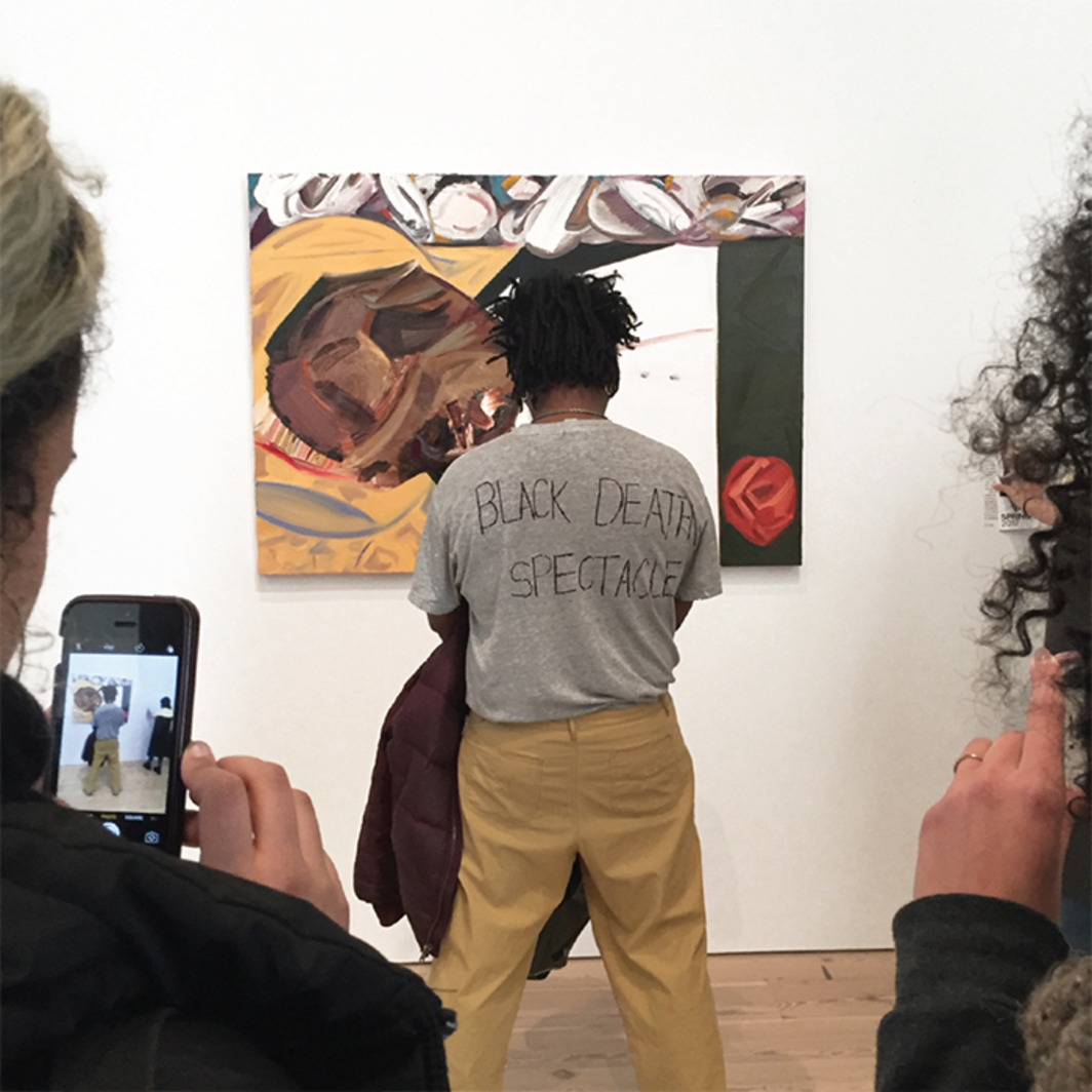 Parker Bright protesting in front of Dana Schutz's Open Casket, 2016, Whitney Museum of American Art, New York, March 17, 2017. Photo: Michael Bilsborough.