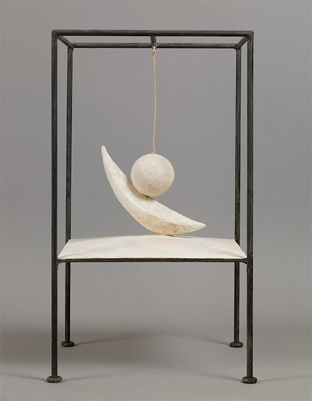 "Alberto Giacometti, Suspended Ball, 1930–31, plaster, metal, 23 7/8 × 14 × 14 1/4"". © Alberto Giacometti Estate/Licensed by VAGA and ARS, New York."