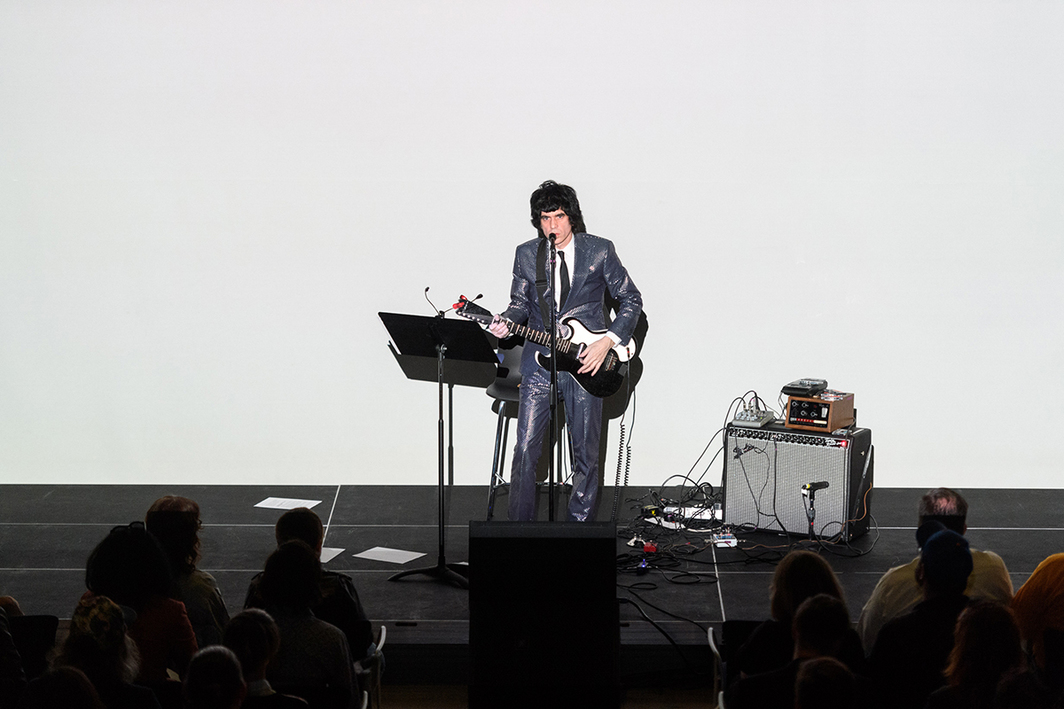 Ian Svenonius performs at the Whitney Museum of American Art, April 14, 2017. Photo: Filip Wolak.