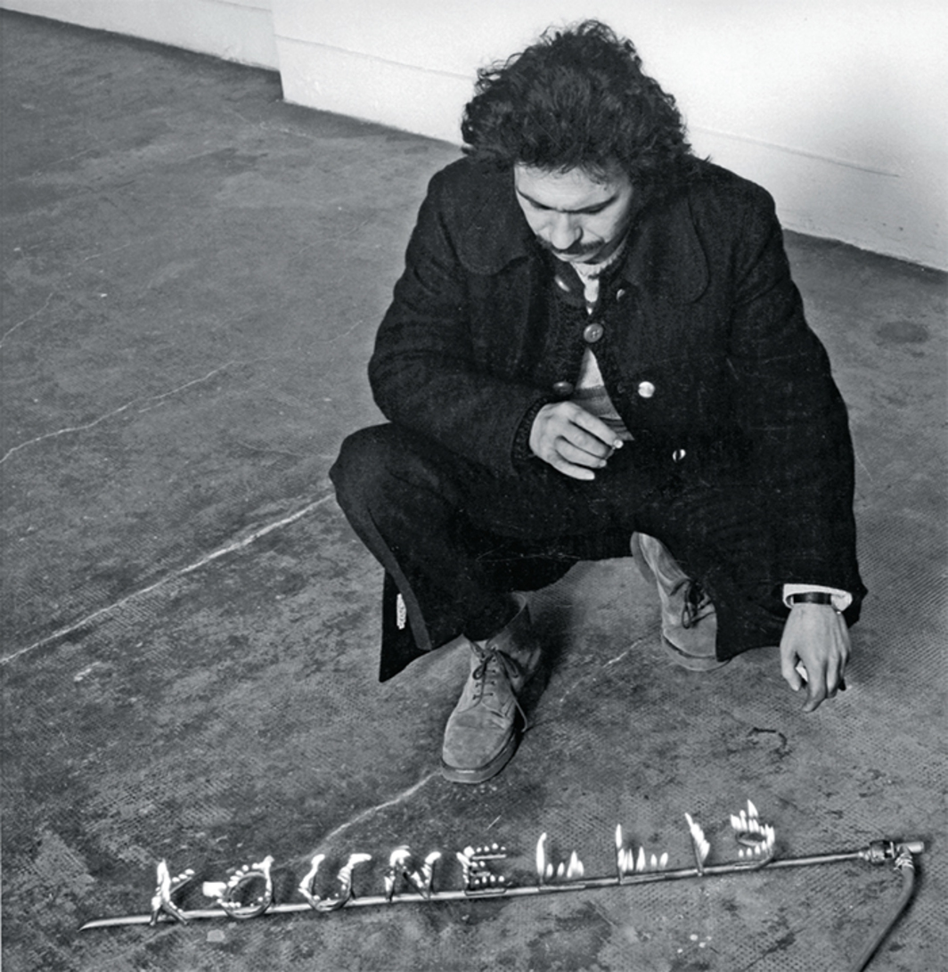 Jannis Kounellis with his Untitled, 1971, Sperone Gallery, Turin. Photo: Claudio Abate. © The Estate of Jannis Kounellis.