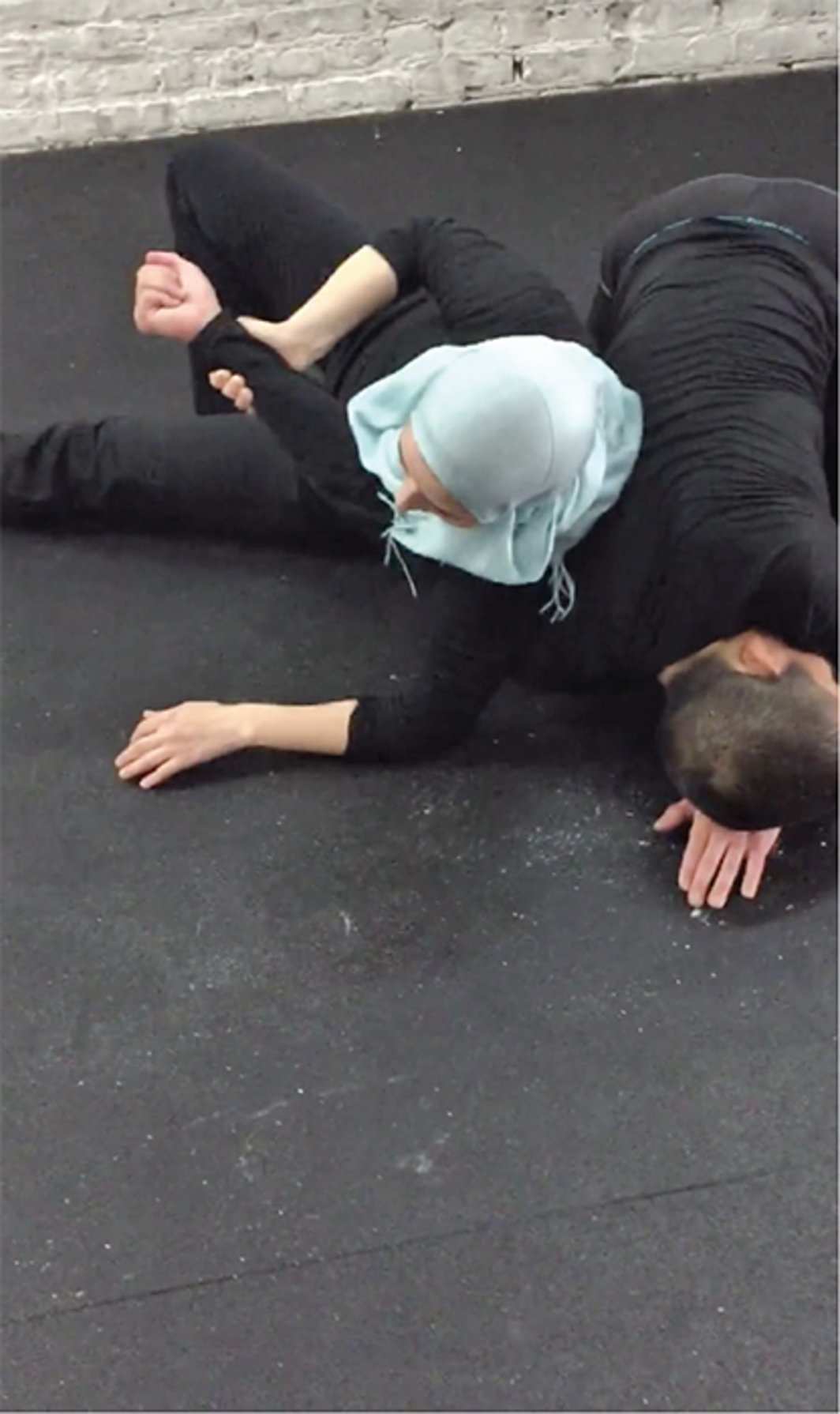 "Still from Zaineb ""Zee"" Abdulla's instructional video on self-defense for Muslim women, 2016."