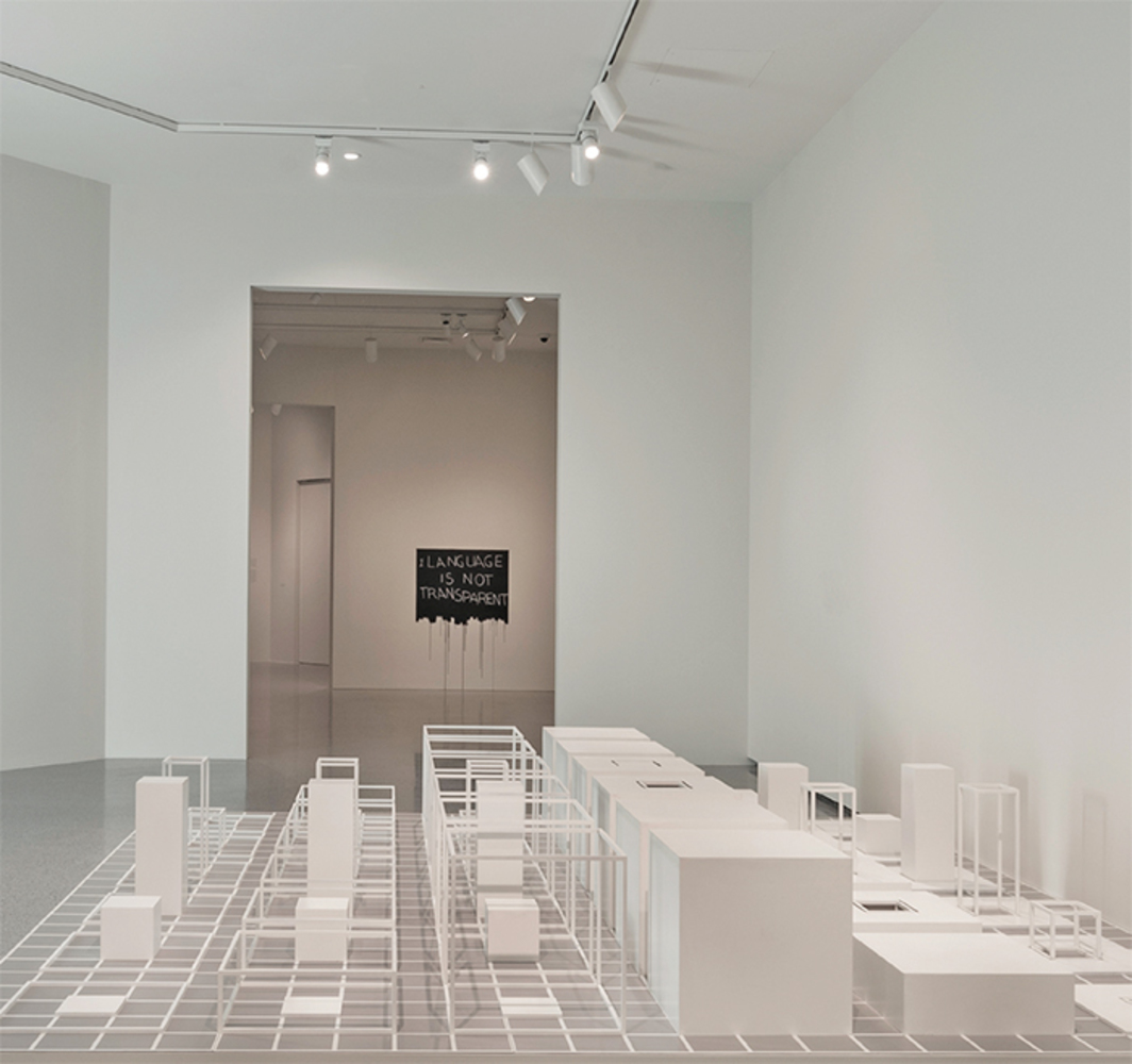 "View of ""Los Angeles to New York: Dwan Gallery, 1959–1971,"" 2016–17. Foreground: Sol LeWitt, Serial Project, 1 (ABCD), 1966. Background: Mel Bochner, Language Is Not Transparent, 1970. Photo: Rob Shelley."
