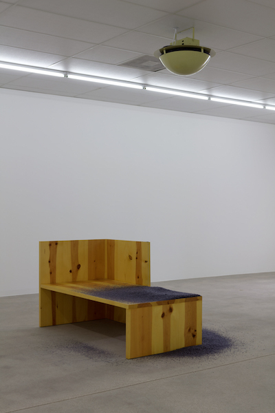 Dora Budor, Year Without a Summer (Judd), 2017, artificial ash, modified confetti disperser, sound sensor, powder-coating paint, Donald Judd's Wintergarden Bench 16, 1980, dimensions variable.