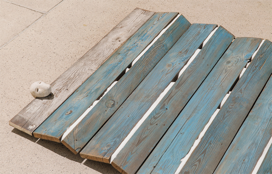 "Mirosław Bałka, 230 x 107 x 10 / Blue Wave (detail), 1990, wood, steel, concrete, salt, 7 7/8 × 90 5/8 × 42 1/8"". Photo: Lorenzo Palmieri."