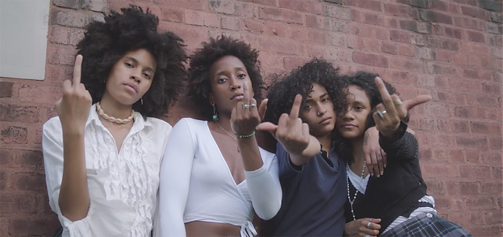 Still from Princess Nokia's 2016 video Brujas, directed by Asli Baykal and Destiny Frasqueri. Third from left: Princess Nokia.