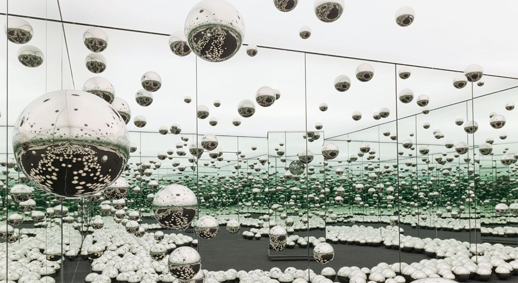 "Yayoi Kusama, Infinity Mirrored Room—Let's Survive Forever, 2017, wood, metal, glass mirrors, LED lighting system, monofilament, stainless steel balls, carpet, 10' 3"" x 20' 6"" x 20' 5 1/4""."
